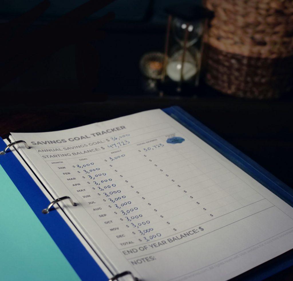 DIY Budget Binder opened to Savings Tracker worksheet